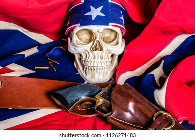 human skull with confederate flag bandanna and leather holster and black revolver on confederate flag