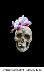 Human skull with a wreath of purple orchids on a black background