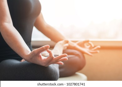 Human spirit meditation therapy, metal balance concept with woman person in yoga lotus pose having spiritual meditating, relaxing in peace silencely in gym class or home indoor in the morning