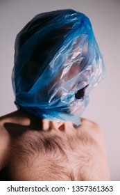 Human suffocating in plastic bag. Plastic pollution problem themed image. STOP using plastic!