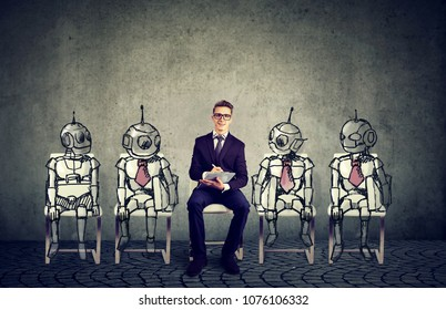 Human vs Robots concept. Business job applicant competing with artificial intelligence