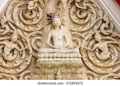 Human-bird wood carved figure on the roof of Petchaburi, Thailand