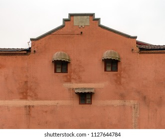 Human-faced brick house