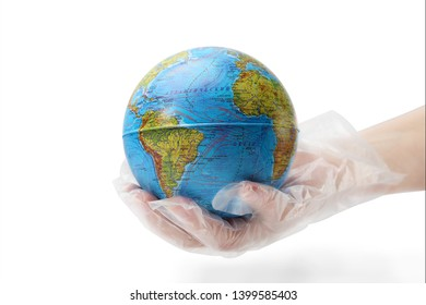 The humanhand in plastic glove holds the planet earth. The concept of protecting the earth from ecological disaster. Isolated white background.
