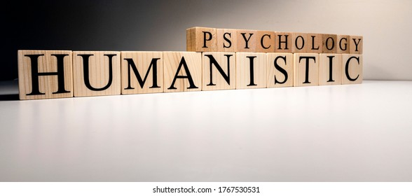 Humanistic psychology text from wooden cubes. The term psychology profession. Close up.