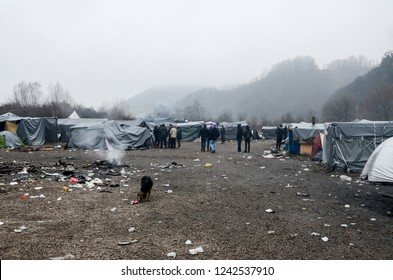 A humanitarian catastrophe in Refugee  Camp In Bosnia. The European migrant crisis. Tents in camp in Velika Kladusa. Asylum seekers, migrants and refugees living in terrible condition