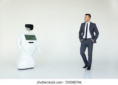 Humanoid autonomous robot with stylish man in a suit. Modern Robotic Technologies. Humanoid autonomous robot. white background