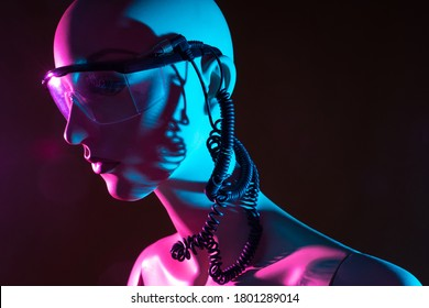 Humanoid cyborg with wires coming out of his head. Close-up portrait of a cyborg. Glasses on face of a humanoid robot. Concept - robot with artificial intelligence. Building robots. Robotics.