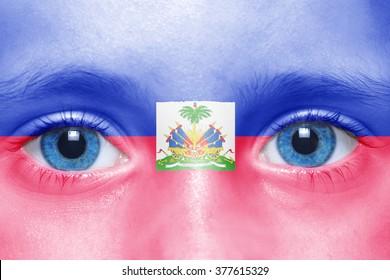 human's face with haitian flag