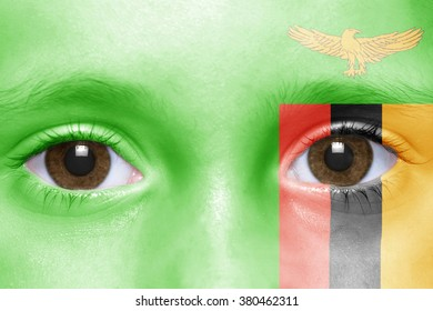 human's face with zambian flag