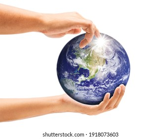 Human's hand was holding a globe and pointed at a bright spot. Environment concept and world guardian organization. Earth image courtesy of NASA.