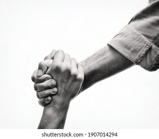 A human's hand saving the another human. Black and white image. Concept of salvation, donorship, helping hand.