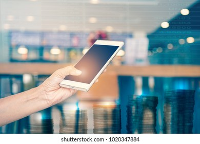 human's hand touched mobile screen for online business, vintage filter