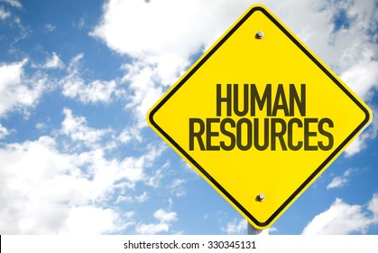 Humans Resources sign with sky background