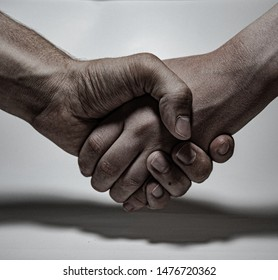 Humans shaking hands after agreement