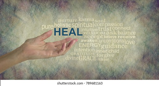 Humble Healing Words - female hand gesturing towards the word HEAL surrounded by a relevant word tag cloud on a rustic stone colored background with dark vignette edged border