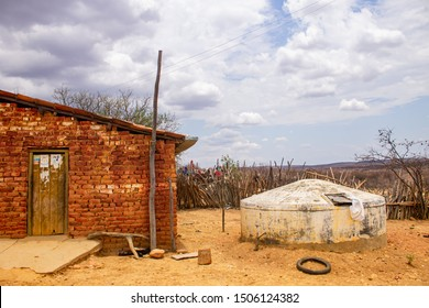 Humble house in the northeast backcountry of Brazil made in bricks with a cistern from a Brazilian program to combat the lack of water and permit your inhabitants to store it after the rain