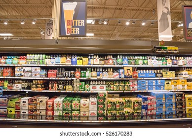 HUMBLE, TEXAS, US-NOV 29,2016: Various bottles of craft, microbrews, IPAs, bitter, ale, wheat, domestic and imported beer styles from around the world on shelf display in store. Alcoholic background.