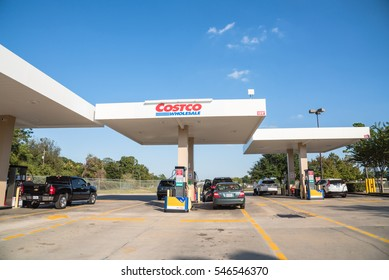 HUMBLE, TEXAS, US-OCT 28, 2016: Costco gas station with customers refueling. Costco Wholesale Corporation is largest membership-only warehouse club in US. It has a total of 705 warehouses worldwide.