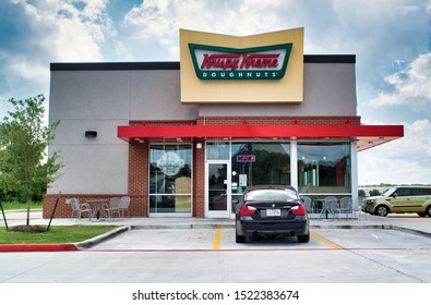 Humble, Texas/USA 09/30/2019: Krispy Kreme Doughnuts on FM 1960 Rd in Humble, TX. Established in North Carolina 1937, it has now become a famous doughnut coffee house with stores worldwide.