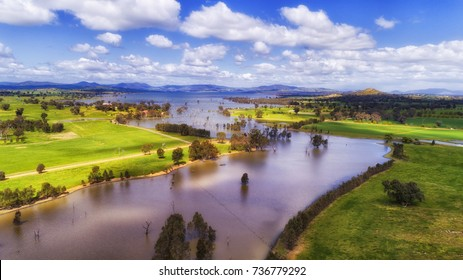 Hume lake, Murray river and Bowna creek surrounded by cultivated agricultural farm fields on a sunny summer day.
