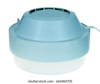 humidifier standing on light background.