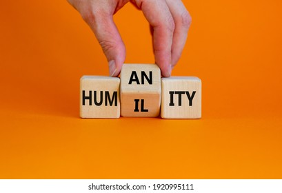 Humility vs humanity symbol. Businessman turns cubes and changes the word 'humility' to 'humanity'. Beautiful orange table, orange background, copy space. Business and humility vs humanity concept.