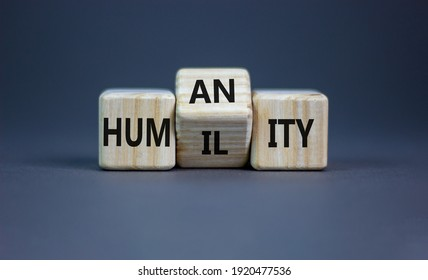 Humility vs humanity symbol. Turned cubes and changed the word 'humility' to 'humanity'. Beautiful grey table, grey background, copy space. Business and humility vs humanity concept.