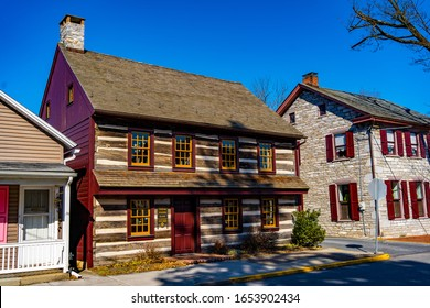 Hummelstown, PA / USA - February 23, 2020: A log house on the main street in the downtown area of Hummelstown.