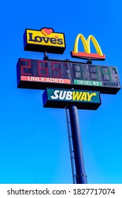 Hummelstown, PA, USA - February 23, 2020:  The Love's Plaza sign includes fuel prices and restaurant logos.