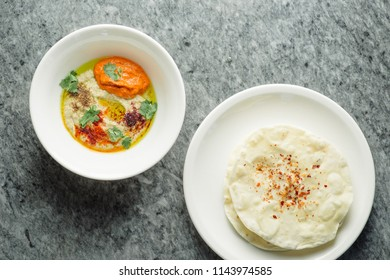 hummus with baked peppers and tortillas