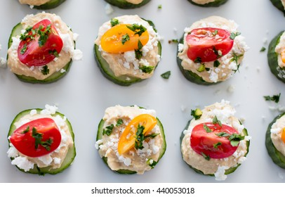 hummus bites with cucumber and tomatoes