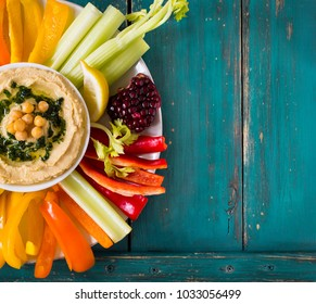 Hummus dip served with fresh vegetable sticks.