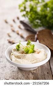 Hummus dip in white bowl