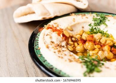 hummus dish with pita bread