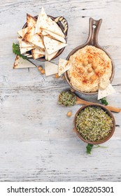 Hummus, traditional arabic healthy vegan chickpeas dip served with pita and sprout