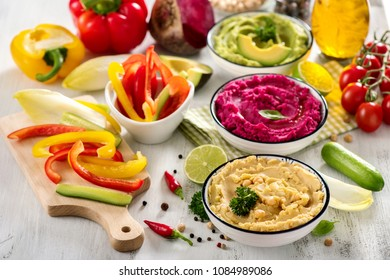 Hummus with vegetables, different dips with cheakpeas, beetroot and avocado