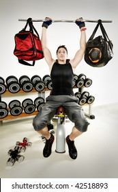 humor about making muscles, bag lifting on gym.