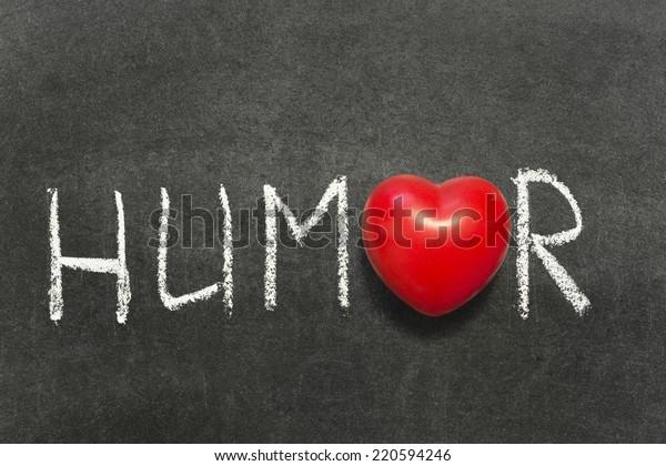 humor word handwritten on blackboard with heart symbol instead of O