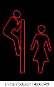 Humoristic neon sign for male and female toilets