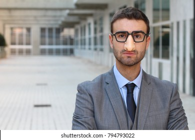 Humorous businessman wearing a disguise