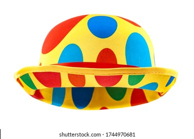 Humorous headgear concept with floating clown bowler hat in red, blue, green and yellow colors  isolated on white background with clipping path cutout using the ghost mannequin technique