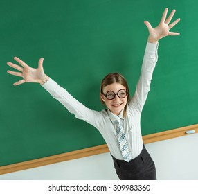Humorous high angle view of Thrilled pupil raise her palms up / photo of teen school girl wearing glasses, creative concept with Back to school theme