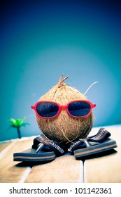 1cdeca1bf6ed1 Humorous image of a coconut gent out sightseeing in his trendy red  sunglasses on his summer
