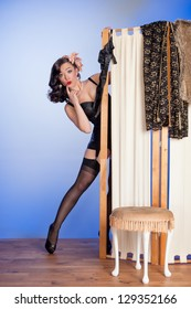 Humorous image of retro pinup discovered in her boudoir