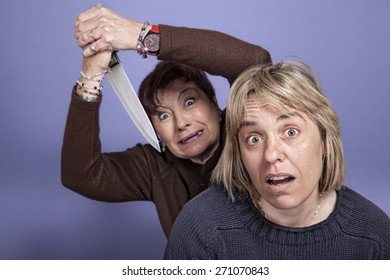 humorous image of a Woman attacked with a knife to a girl from behind