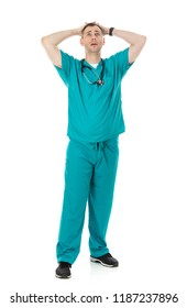 Humorous male doctor in scrubs in a variety of poses on a white isolated background. Male physician is tired and exhausted.