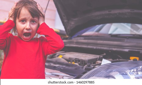 Humorous photo of beautiful little child girl open hood of her broken car. She having panic attack.
