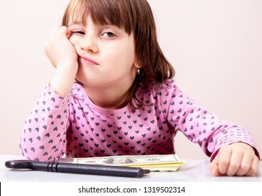 Humorous photo: cute little child girl search and thinking about key to success and wealth