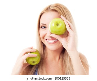 humorous portrait of a  young woman  holding two apples, isolated against white background